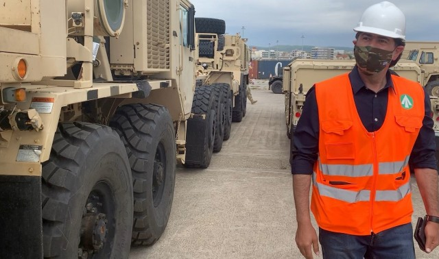 Michael Pittas, Terminal Manager (US Army), Transportation Corps, Eastern Mediterranean Detachment (Greece), supervises the vessel discharge and initial staging operations of U.S. Army equipment at the port in Alexandroupoli, Greece.