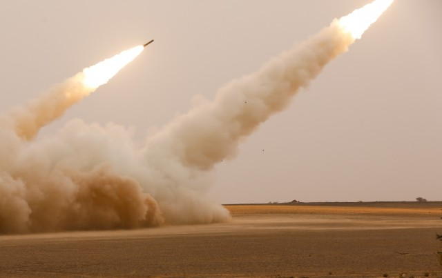 U.S. Army Soldiers assigned to Alpha Battery, 1st Battalion, 77th Field Artillery Regiment, 41st Field Artillery Brigade, fire the High Mobility Artillery Rocket System during African Lion 2021, at Guirer Libouihi Air Base, on June 9, 2021. The 41st FAB is conducting a suppression of enemy air defense in support of an Airborne joint Forcible Entry during African Lion 2021. This dynamic force employment exercise is their fourth exercise in the Fires Shock series, and a sub-exercise of U.S. Army Europe and Africa's Defender 21. African Lion 2021 is U.S. Africa Command's largest, premier, joint, annual exercise hosted by Morocco, Tunisia, and Senegal, 7-18 June. More than 7,000 participants from nine nations and NATO train together with a focus on enhancing readiness for U.S. and partner nation forces. AL21 is a multi-domain, multi-component, and multinational exercise, which employs a full array of mission capabilities with the goal to strengthen interoperability among participants. (U.S. Army photo by Spc. Zack Stahlberg)