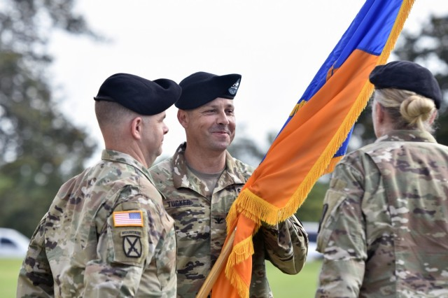 U.S. Army Col. Richard P. Tucker receives the unit colors for the first time as commander during the 1st Aviation Brigade change of command ceremony at Fort Rucker, Alabama, June 18, 2021. (U.S. Army photo by Lt. Col. Andy Thaggard)