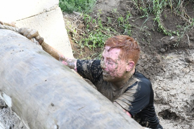 """More than 600 community members answered the """"call to dirty"""" on June 18 and completed the annual Mountain Mudder – a 5.5-mile course with 25 obstacles guaranteed to challenge both the mind and body (as well as your laundry detergent!). The Mudder, hosted by Fort Drum Family and Morale, Welfare and Recreation (FMWR) and the Better Opportunities for Single Soldiers (BOSS) program, had twice as many obstacles as last year, and had all the wet, muddy, and even soapy, fun that participants have come to expect every year. (Photo by Mike Strasser, Fort Drum Garrison Public Affairs)"""