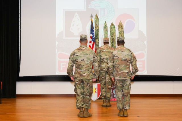 Fort Benning, Ga- COL James G. Pairmore and CSM Tony Flanagan lead the casing of the colors ceremony for the 14th Combat Support Hospital June 21, 2021 in Derby Auditorium. 14th CSH will be relocating to Fort Stewart as the 14th Field Support Hospital. (U.S. Army photos by Markeith Horace, Fort Benning Maneuver Center of Excellence photographer)