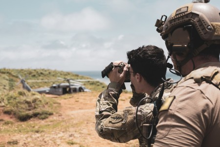 U.S. Army Green Berets assigned to 1st Battalion, 1st Special Forces Group (Airborne) observe a target for a U.S. Navy Sikorsky HH-60 helicopter with the Helicopter Sea Combat Squadron 85 during Close Air Support Training in Okinawa, Japan, May 13, 2021. Green Berets trained using the 5-line Call for Fire, directing the aircraft to targets in order to support ground force elements.