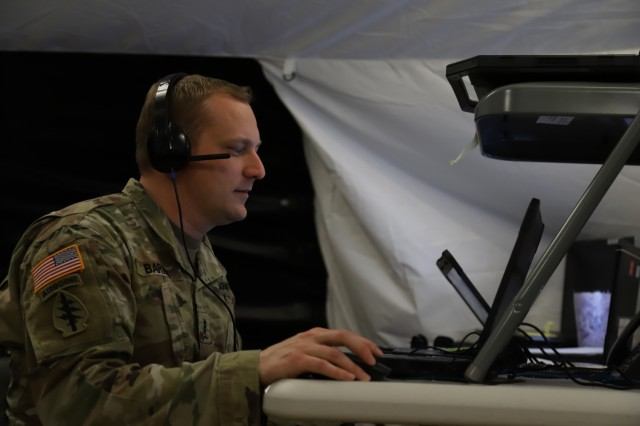 A V Corps Soldier works at his computer during the Defender Europe 21 command post exercise, June 3, 2021, on Fort Knox Kentucky. The CPX was another step in the Victory Corps march to full operational capability and becoming a certified warfighting headquarters.