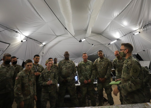 A group of V Corps Soldiers conduct a shift change brief during the Defender Europe 21 command post exercise, June 10, 2021, on Fort Knox, Kentucky. The CPX was another step in the Victory Corps march to full operational capability and becoming a certified warfighting headquarters.
