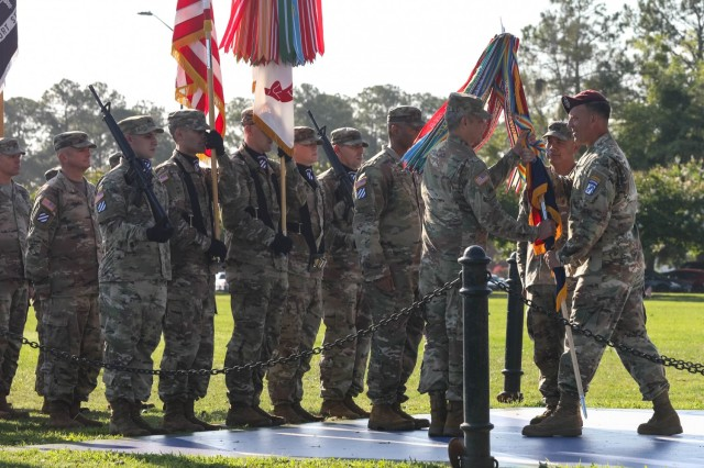 U.S. Army Lt. Gen. Michael Kurilla, commanding general of the XVII Airborne Corps, passes the 3rd Infantry Division colors to Maj. Gen. Charles D. Costanza, incoming commander, during a Change of Command Ceremony, June 21, 2021. Passing the unit colors is symbolic of the transfer of responsibility and command. (U.S. Army Photo by Pfc. Caitlin Wilkins, 50th Public Affairs Detachment)