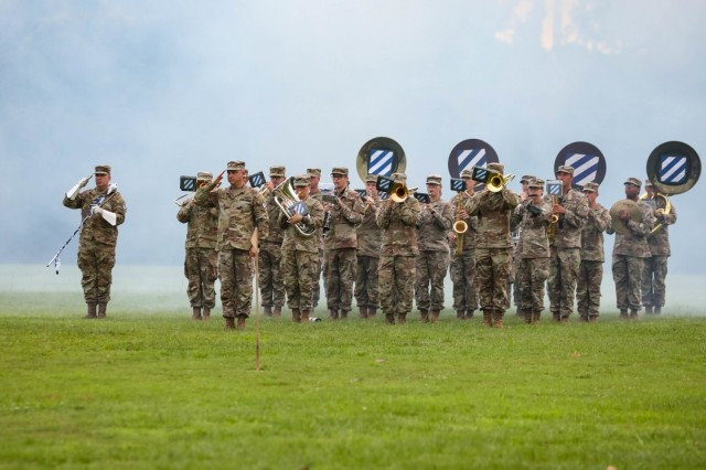 The U.S. Army 3rd Infantry Division Band plays the national anthem during a Division Change of Command Ceremony, June 21, 2021. Maj. Gen. Antonio A. Aguto relinquished command of the 3rd ID to Maj. Gen. Charles D. Costanza at Cottrell Field, Fort Stewart, Georgia. Aguto led the Division through Hurricane Dorian impacts, the global COVID-19 pandemic and multiple subordinate units' deployments to U.S. Central Command area of responsibility, Europe, and Pacific.  (U.S. Army Photo by Pfc. Caitlin Wilkins, 50th Public Affairs Detachment)