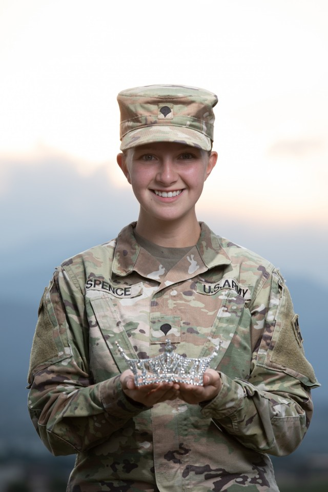 Spc. Maura Spence, a Katy, Texas native and an intelligence analyst assigned to Headquarters and Headquarters Company, 23rd Infantry Regiment, 1st Stryker Brigade Combat Team, 4th Infantry Division, displays her crown after winning first place in the Miss Colorado 2021 pageant, June 8, 2021. Spence is scheduled to attend the Miss America 2022 pageant in December 2021 at Mohegan Sun, Connecticut. (U.S. Army photo by Spc. Matthew Marsilia)