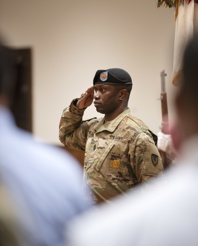 Garrison Command Sgt. Maj. Algrish Williams Sr., salutes during the playing of the National Anthem at the Fort Jackson Garrision change of command ceremony June 15 at Victory Hall on post.