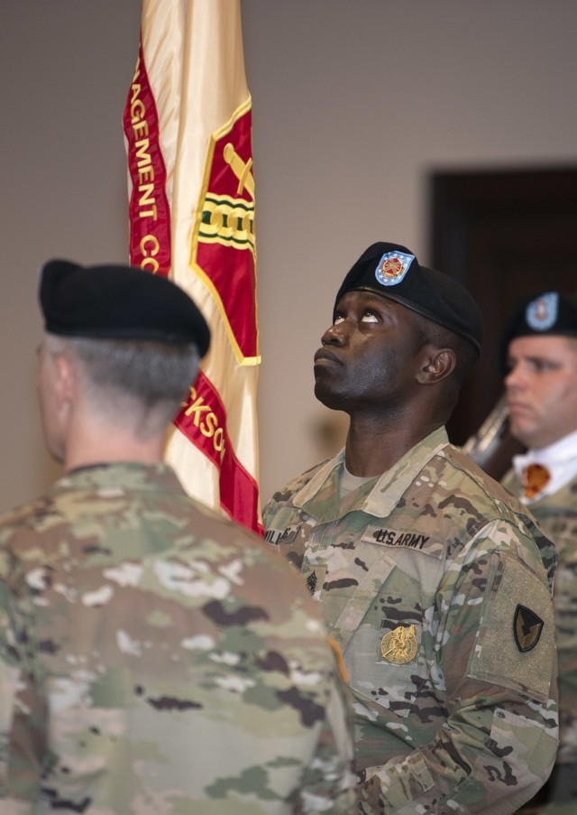 Garrison Command Sgt. Maj. Algrish Williams checks the unit colors before handing them to Col. John 'Wes' Hankins during a Fort Jackson Garrision change of command ceremony June 15 at Victory Hall on post. Hankins relinquished command of the unit to Col. Ryan Hanson.