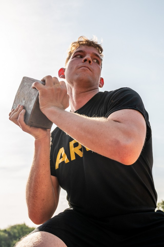A Soldier prepares to throw a stone during a German Sports Badge event on Panzer Kaserne, Germany, June 19, 2021.