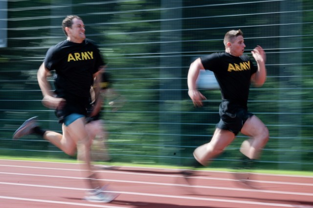 Soldiers race across the finish line during a German Sports Badge event on Panzer Kaserne, Germany, June 19, 2021.
