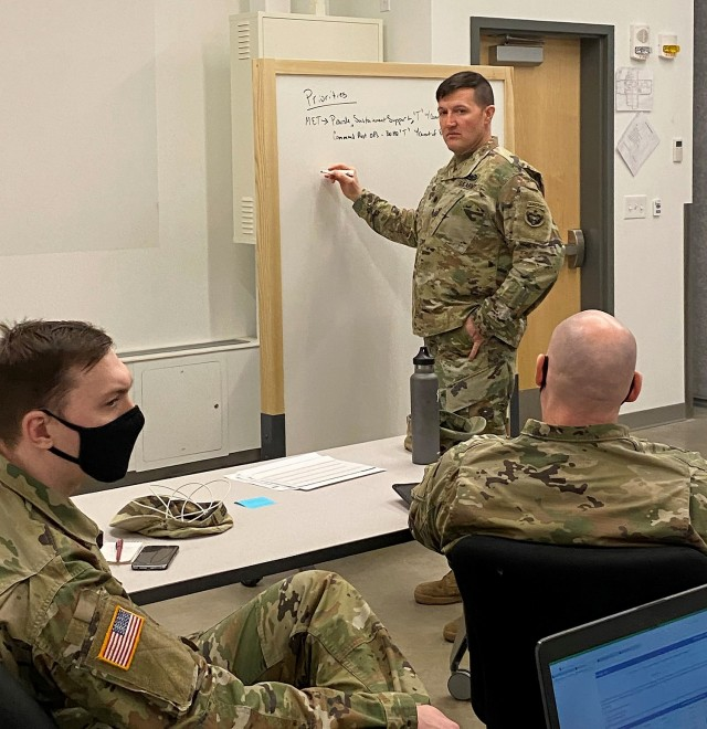 Lt. Col. Jerimiah Hull, 17th Combat Sustainment Support Battalion commander, leads a staff planning session to determine the commander's FY22 training guidance during training management training for the 17th CSSB April 19-22 at Joint Base Elmendorf-Richardson, Ala. The Training Management Directorate sends the mobile training teams to requesting units to help with the training management process and can customize the experience based on the commander's training goals. Photo by Donald Motley, TMD.