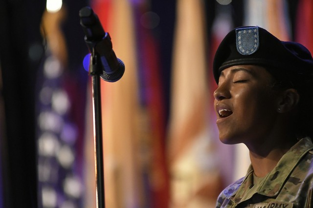 Pvt. Kelice Hines, a U.S. Army Quartermaster School advanced individual training student, belts out the national anthemn during a 23rd QM Brigade change of command ceremony June 23rd at the Lee Theater. Hines is a Brooklyn native.