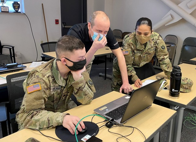 Bart Hobbs, Digital Training Management System trainer, provides hands-on technical assistance to members of the 95th Chemical Company, 2nd Engineer Brigade, during training for the 17th Combat Sustainment Support Battalion April 19-22 at Joint Base Elmendorf-Richardson, Ala. The Training Management Directorate sends the mobile training teams to requesting units to help with the training management process and can customize the experience based on the commander's training goals. Photo by Donald Motley, TMD.