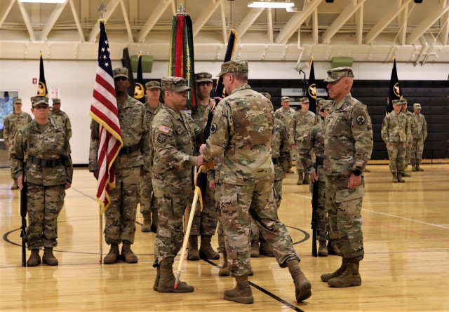 Deputy Commanding General of the U.S. Army Reserve Command Maj. Gen. Gregory Mosser passes the unit's colors to incoming Army Reserve Careers Group Commander Col. Frederick Hockett June 24 at Fort Knox's Sadowski Center