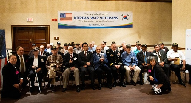 U.S. Army Aviation and Missile Command Commander Maj. Gen. Todd Royar poses with a group of Korean War veterans after the 15th Annual Korean War Veterans Luncheon June 24 at The Summit on Redstone Arsenal, Ala.