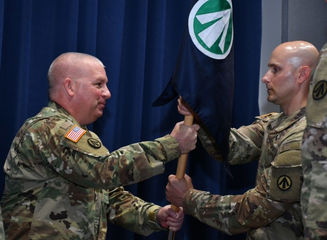 Col. Stephen York, Military Surface Deployment and Distribution Command chief of staff, hands the command guidon to Capt. Clinton Allen, the command's new Headquarters and Headquarters Detachment commander June 24, 2021 on Scott Air Force Base, Illinois.