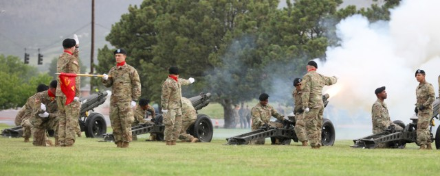 Artillerymen with Battery A, 3rd Battalion, 29th Field Artillery Regiment, 3rd Armored Brigade Combat Team, 4th Infantry Division fire cannons during a change of command ceremony for 2nd Stryker Brigade Combat Team, 4th Inf. Div. June 25, 2021 at Fort Carson, Colo. The change of command ceremony is a time-honored tradition in which the outgoing commander formally transfers their authority to the incoming commander. (U.S. Army photo by Sgt. Gabrielle Pena)