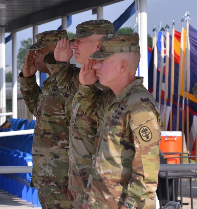 Fort Hood, Texas - Col. Daniel J. Moore, commander, Carl R. Darnall Army Medical Center (right), stands at attention with Brig. Gen. Shan K. Bagby, commander, Regional Health Command-Central (left) and assumes command from Col. Richard G. Malish on Sadowski Field June 23.