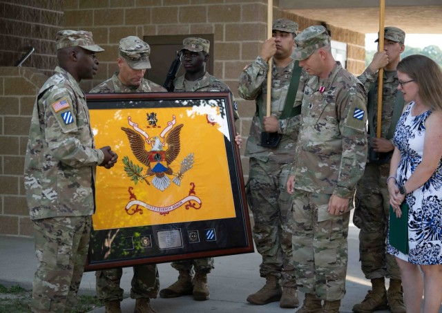 Lt. Col. Steven L. Chadwick, outgoing commander of the 3rd Battalion, 67th Armored Regiment, 2nd Armored Brigade Combat Team, 3rd Infantry Division, receives a farewell plaque from his unit presented to him from senior enlisted advisor, Command Sgt. Maj. Matakiah Fogle Jr., before the 3rd Bn., 67th AR's change of command ceremony at Cottrell parade field on Fort Stewart, Georgia June 16, 2021. (U.S Army Photo by Spc. Devron Bost)