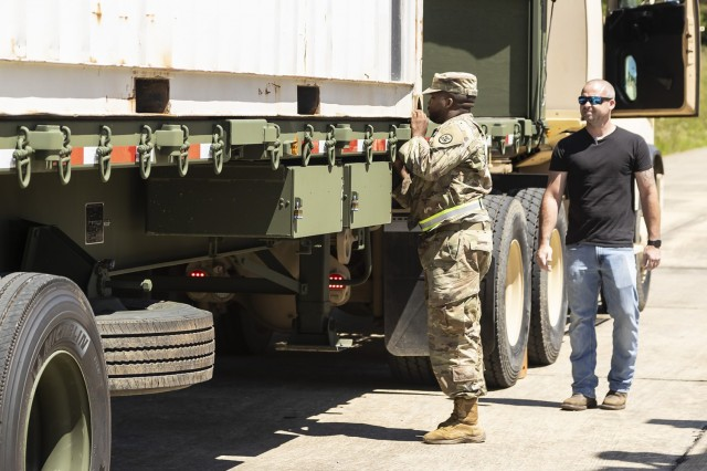 A Soldier from the Alabama Army National Guard's 781st Transportation Company secures an outbound load destined for Bluegrass Army Depot in Kentucky.