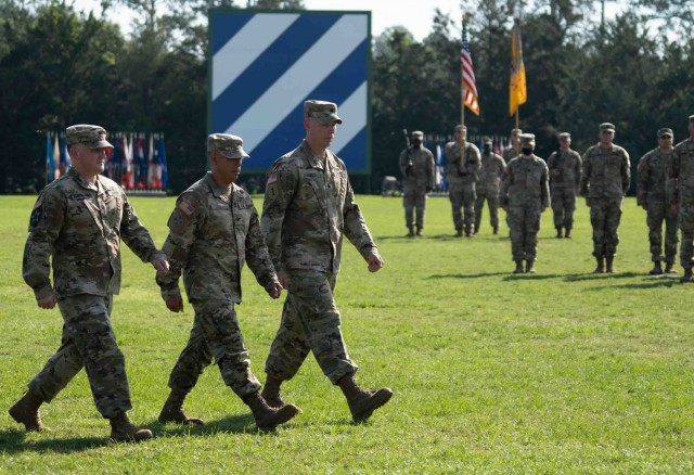 Lt. Col. Daniel G. Hodermarsky, left, incoming commander of the 3rd Battalion, 67th Armored Regiment, 2nd Armored Brigade Combat Team, Col. Terry R. Tillis, middle, commander of the 2nd Armored Brigade Combat Team, 3rd Infantry Division, and Lt. Col. Steven L. Chadwick, (right) outgoing commander, complete the inspection of troops during the 3rd Bn., 67 AR's change of command ceremony at Cottrell Field on Fort Stewart, Georgia June 16, 2021. (U.S Army Photo by Spc. Devron Bost)