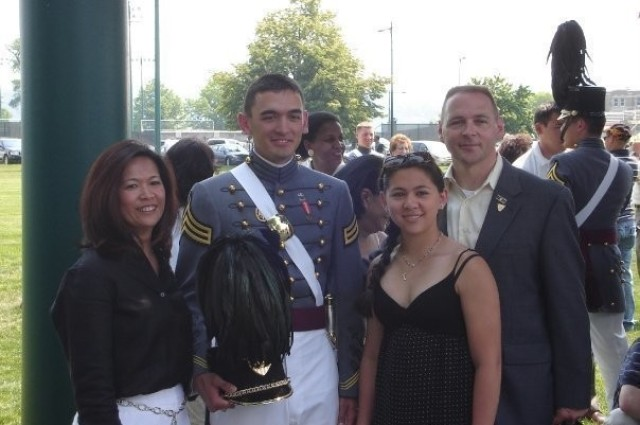 Maj. Donald A. Schmidt II, the executive officer of the 9th Brigade Engineer Battalion, 2nd Armored Brigade Combat Team, 3rd Infantry Division, is with his family after conducting his final parade as a cadet during the U.S. Military Academy's graduation week at West Point, New York, May 2007. The Army is proud of its lesbian, gay, bisexual, transgender or questioning Soldiers who serve with distinction and are role models for exemplifying the Army's highest values. (Courtesy Photo)