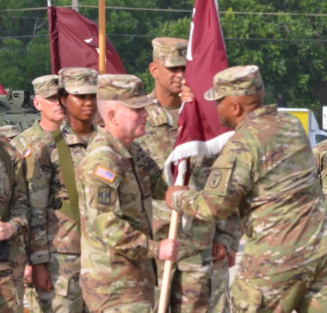 Fort Hood, Texas - Col. Daniel J. Moore, commander, Carl R. Darnall Army Medical Center, receives the guidon from Brig. Gen. Shan K. Bagby, commander, Regional Health Command-Central and assumes command from Col. Richard G. Malish on Sadowski Field June 23.
