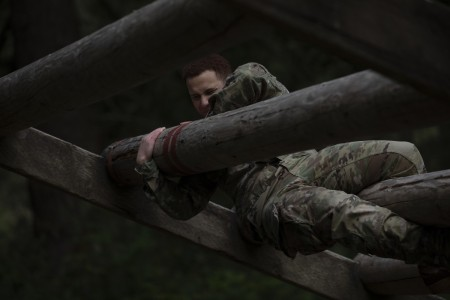 A U.S. Army Soldier from 1st Special Forces Group (Airborne) navigates the weaver obstacle during an obstacle course for the 1st Special Forces Group Best Warrior Competition at Joint Base Lewis-McChord, WA, May 19, 2021.  The Best Warrior Competition was a week-long crucible that tested candidates on their military proficiency and physical stamina through a rifle and pistol qualification, land navigation, an obstacle course, an Army Combat Fitness Test as well as a road march.  The competition also tested the candidates' mental fortitude through a written test on general Soldier knowledge, an essay and a board.