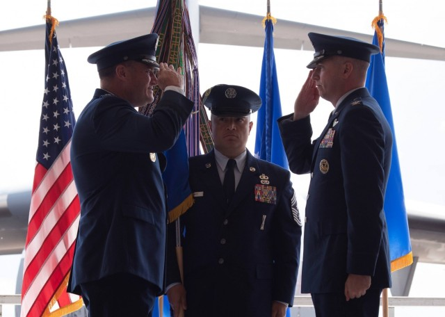 (On right) U.S. Air Force Col. David A. Fazenbaker, 62nd Airlift Wing commander, salutes Maj. Gen. Kenneth T. Bibb Jr., 18th Air Force commander, after taking command of the 62nd AW at Joint Base Lewis-McChord, Washington, June 15, 2021. The 62nd AW commander ensures the readiness of more than 2,400 active-duty and civilian personnel along with 40 permanently assigned C-17 Globemaster III aircraft to support worldwide combat and humanitarian airlift and airdrop operations. (U.S. Air Force photo by Senior Airman Zoe Thacker)