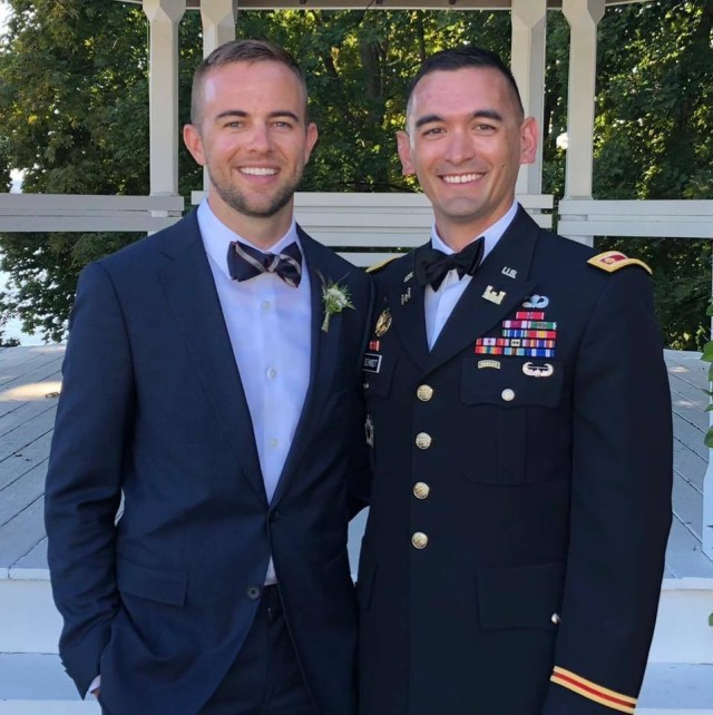 Maj. Donald A. Schmidt II, right, the executive officer of the 9th Brigade Engineer Battalion, 2nd Armored Brigade Combat Team, 3rd Infantry Division, with his spouse, left, attend a friend's wedding in Lake Winnipesaukee, New Hampshire, October 2020. The Army is proud of its lesbian, gay, bisexual, transgender or questioning Soldiers who serve with distinction and are role models for exemplifying the Army's highest values. (Courtesy Photo)