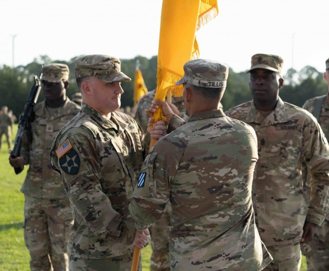 Lt. Col. Daniel G. Hodermarsky, incoming commander of the 3rd Battalion, 67th Armored Regiment, 2nd Armored Brigade Combat Team, 3rd Infantry Division, receives the unit's colors from Col. Terry R. Tillis, commander of the 2nd ABCT, 3rd ID, during 3rd Bn., 67th AR's of command ceremony at Cottrell Field on Fort Stewart, Georgia, June 16, 2021.  (U.S Army Photo by Spc. Devron Bost)