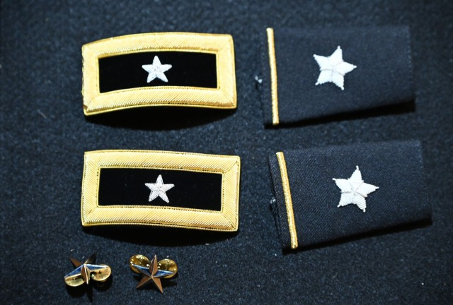 Brig. Gen. Michelle K. Donahue's shoulder boards, epaulets and beret pins. Donahue was promoted to brigadier general during a ceremony June 21 at the Army Women's Museum at Fort Lee.