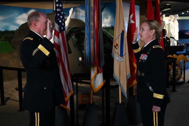 Retired Gen. Martin E. Dempsey, former Chairman of the Joints Chiefs of Staff, administers the oath of office to Brig. Gen. Michelle K. Donahue, 56th Quartermaster General, at a promotion ceremony June 21 at the Army Women's Museum at Fort Lee.