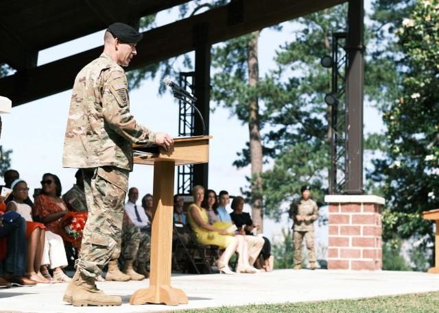 Col. Jeremy St. Laurent addresses the guests at the 597th Transportation Bde.Change of Command Ceremony at Magnolia Park, Fort Eustis, Va. June 25.