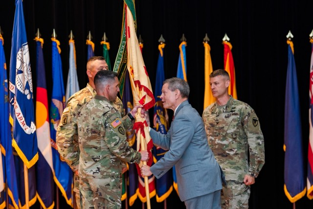 Director of Installation Management Command-Training Vincent Grewatz passes the Fort Knox Garrison colors to incoming commander Col. Lance O'Bryan June 30 at Waybur Theater.