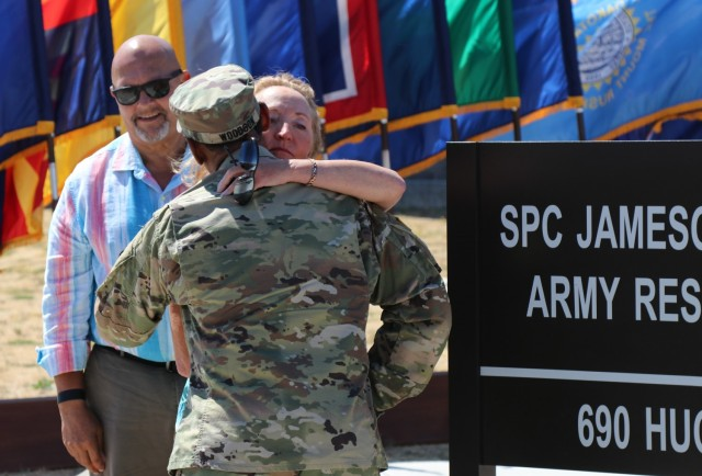 After the unveiling of the Spc. Jameson L. Lindskog U.S. Army Reserve Center plaque during the building memorialization ceremony, left, Mr. Curtis Lindskog, his father, pauses, as Maj. Gen. Jonathan Woodson, commanding general, Army Reserve Medical Command, embraces Mrs. Jo Lindskog, Lindskog's stepmother, as a show of support, June 29, 2021 at Parks Reserve Forces Training Area in Dublin, Calif. Lindskog, a resident of Pleasanton, Calif., was killed in action March 29, 2011 while serving as a combat medic with the 2nd Battalion, 327th Infantry Regiment, 1st Brigade Combat Team, 101st Airborne Division in Afghanistan. He posthumously received the Silver Star for his heroic actions that day.  (Photo by Sgt. 1st Class Matthew Chlosta)