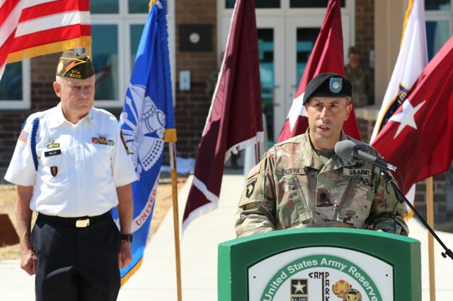 Left, Mr. Doug Miller, the master of ceremony, listens to remarks from Lt. Col. Joseph DaSilva, commander, 2nd Battalion, 327th Infantry Regiment, 1st Brigade Combat Team, 101st Airborne Division during the Spc. Jameson L. Lindskog U.S. Army Reserve Center memorialization ceremony June 29, 2021 at Parks Reserve Forces Training Area in Dublin, Calif. Lindskog, a resident of Pleasanton, Calif., was killed in action March 29, 2011 while serving as a combat medic with the 2nd Bn., 327th Inf. Regmt., 1st BCT, 101st Airborne Division in Afghanistan. He posthumously received the Silver Star for his heroic actions that day. (Photo by Sgt. 1st Class Matthew Chlosta)