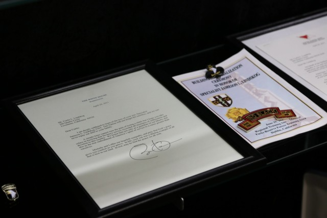 A condolence letter from former President Barack Obama to Mr. Curtis Lindskog rests in the glass display case memorial, inside Spc. Jameson L. Lindskog U.S. Army Reserve Center after a memorialization ceremony June 29, 2021 at Parks Reserve Forces Training Area in Dublin, Calif. Lindskog, a resident of Pleasanton, Calif., was killed in action March 29, 2011 while serving as a combat medic with the 2nd Battalion, 327th Infantry Regiment, 1st Brigade Combat Team, 101st Airborne Division in Afghanistan. He posthumously received the Silver Star for his heroic actions that day. (Photo by Sgt. 1st Class Matthew Chlosta)