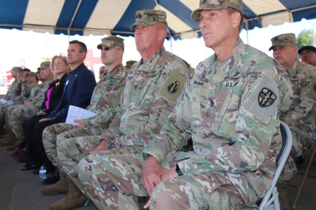 Center, Command Sgt. Maj. Patrick McKie, senior enlisted leader, 63rd Readiness Division and Command Sgt. Maj. Robert Boudnik, senior enlisted leader, Army Reserve Medical Command listen to a speaker during the Spc. Jameson L. Lindskog U.S. Army Reserve Center memorialization ceremony June 29, 2021 at Parks Reserve Forces Training Area in Dublin, Calif. Lindskog, a resident of Pleasanton, Calif., was killed in action March 29, 2011 while serving as a combat medic with the 2nd Battalion, 327th Infantry Regiment, 1st Brigade Combat Team, 101st Airborne Division in Afghanistan. He posthumously received the Silver Star for his heroic actions that day. (Photo by Sgt. 1st Class Matthew Chlosta)