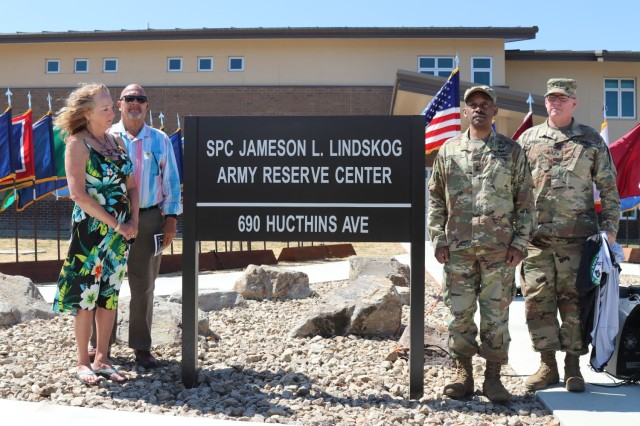 During the Spc. Jameson L. Lindskog U.S. Army Reserve Center memorialization ceremony, from left to right, Mrs. Jo Lindskog, Lindskog's stepmother, looks at the just unveiled plaque as her and Mr. Curtis Lindskog, Lindskog's father; Maj. Gen. Jonathan Woodson, commanding general, Army Reserve Medical Command and Brig. Gen. Joseph Marsiglia, commanding general, Army Reserve Medical Readiness and Training Command listen to the reading of the Army Reserve Center dedication by Mr. Doug Miller, the master of ceremony, June 29, 2021 at Parks Reserve Forces Training Area in Dublin, Calif. Lindskog, a resident of Pleasanton, Calif., was killed in action March 29, 2011 while serving as a combat medic with the 2nd Battalion, 327th Infantry Regiment, 1st Brigade Combat Team, 101st Airborne Division in Afghanistan. He posthumously received the Silver Star for his heroic actions that day. (Photo by Sgt. 1st Class Matthew Chlosta)