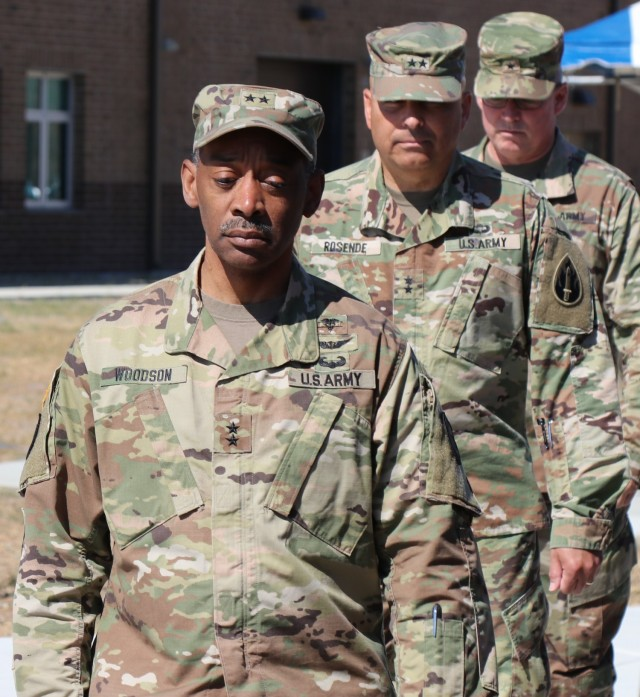 Left to right, Maj. Gen. Jonathan Woodson, commanding general, Army Reserve Medical Command, Maj. Gen. Alberto Rosende, commanding general, 63rd Readiness Division Brig. Gen. Joseph Marsiglia, commanding general, Army Reserve Medical Readiness and Training Command march during the Spc. Jameson L. Lindskog U.S. Army Reserve Center memorialization ceremony June 29, 2021 at Parks Reserve Forces Training Area in Dublin, Calif. Lindskog, a resident of Pleasanton, Calif., was killed in action March 29, 2011 while serving as a combat medic with the 2nd Battalion, 327th Infantry Regiment, 1st Brigade Combat Team, 101st Airborne Division in Afghanistan. He posthumously received the Silver Star for his heroic actions that day. (Photo by Sgt. 1st Class Matthew Chlosta)