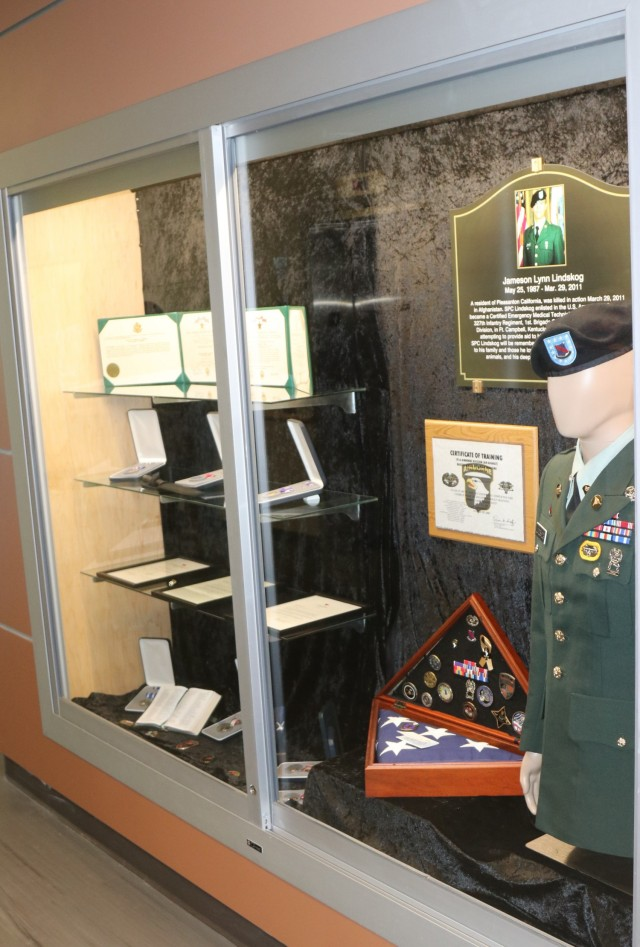 A memoriam flag box sits in the glass display case memorial, inside Spc. Jameson L. Lindskog U.S. Army Reserve Center after a memorialization ceremony June 29, 2021 at Parks Reserve Forces Training Area in Dublin, Calif. Lindskog, a resident of Pleasanton, Calif., was killed in action March 29, 2011 while serving as a combat medic with the 2nd Battalion, 327th Infantry Regiment, 1st Brigade Combat Team, 101st Airborne Division in Afghanistan. He posthumously received the Silver Star for his heroic actions that day. (Photo by Sgt. 1st Class Matthew Chlosta)