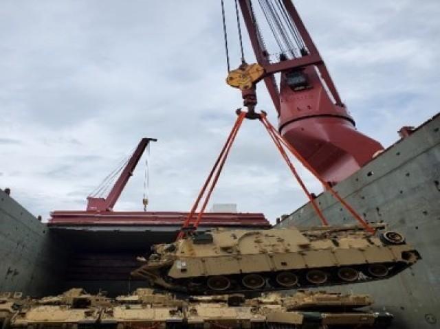 Abrams Tank is loaded on the Ocean Freedom vessel
