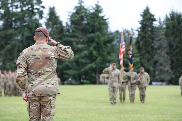 Col. Jonathan Chung renders a salute to 5th Security Force Assistance Brigade Command Sgt. Maj. Rob Craven at Joint Base Lewis McChord, Washington, June 30, 2021 during the 5th SFAB's Assumption of Command Ceremony.