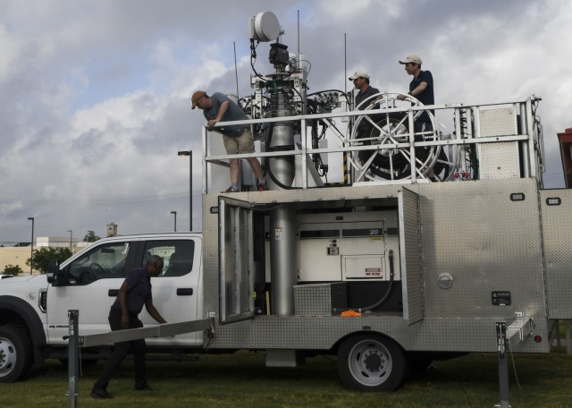 U.S. Army North's G6 staff along with Joint Base San Antonio's 5G Program Management Office staff troubleshoot the 5th Generation Cell on Light Truck (5G CoLT), during a week-long training event, June 21-25, 2021 held at JBSA-Fort Sam Houston. These 5G CoLTs are part a three-year experiment, which are in line with the Army's modernization efforts, that provide Soldiers with equipment and data systems while simultaneously testing, upgrading and, fielding multi-domain technologies. (U.S. Army Photo by Bethany Huff)