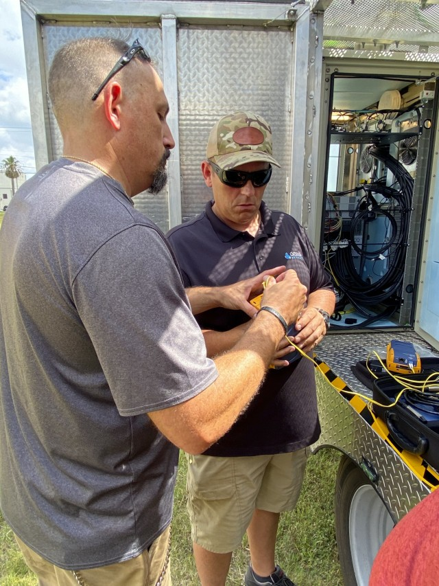 Christopher Rowand, telecommunications manager, left, at U.S. Army North, and Scott Beadell, right, OCEUS instructor, test the fiber connection on the 5th Generation Cell on Light Truck (5G CoLT), during a week-long training event, June 21-25, held at JBSA-Fort Sam Houston. These 5G CoLTs are part a three-year experiment, which are in line with the Army's modernization efforts, that provide Soldiers with equipment and data systems while simultaneously testing, upgrading and, fielding multi-domain technologies. (U.S. Army Photo by Bethany Huff)