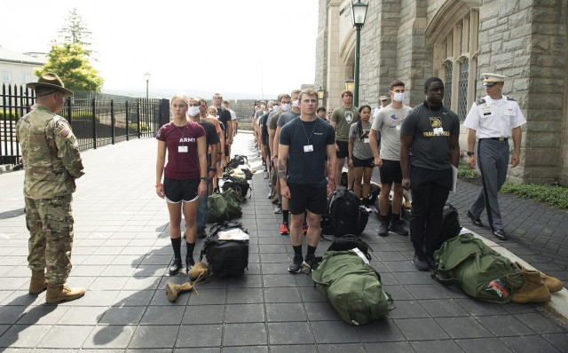Under the watchful eye of Class of 2023 Cadet Christian Hunt (far right) and a drill sergeant from 2-19th Infantry Battalion, 198th Infantry Training Brigade One Station Unit Training from Fort Benning, Ga., approximately 400 new cadets reported each day over the course of three days, Saturday through Monday, to the U.S. Military Academy for Reception Day. The three days mark the beginning of Cadet Basic Training and the first day of their transition from civilian to new cadet for a majority of the members of the Class of 2025.