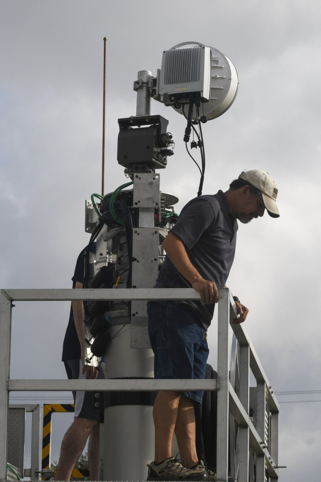 Harold Le Dour, a satellite communications analyst with U.S. Army North, helps to troubleshoot one of the 5th Generation Cell on Light Truck (5G CoLT), during a week-long training event, June 21-25, 2021 held at Joint Base San Antonio-Fort Sam Houston. These 5G CoLTs are part a three-year experiment, which are in line with the Army's modernization efforts, that provide Soldiers with equipment and data systems while simultaneously testing, upgrading and, fielding multi-domain technologies. (U.S. Army Photo by Bethany Huff)