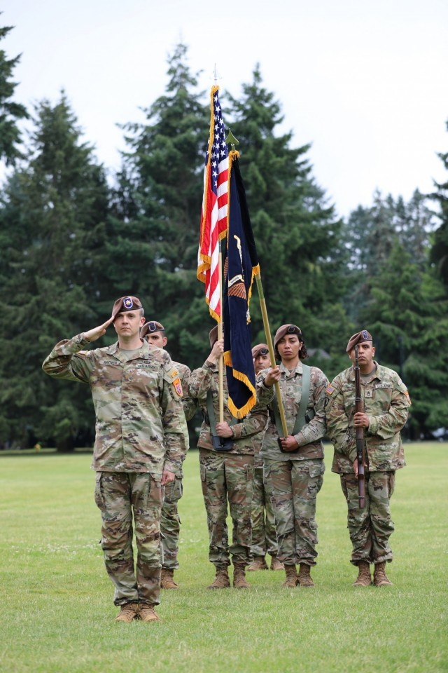 The 5th Security Force Assistance Brigade Executive Officer, Maj. Paul Brown renders a salute as commander of troops during the 5th SFAB's Assumption of Command ceremony at Joint Base Lewis McChord, Washington, June 30, 2021.